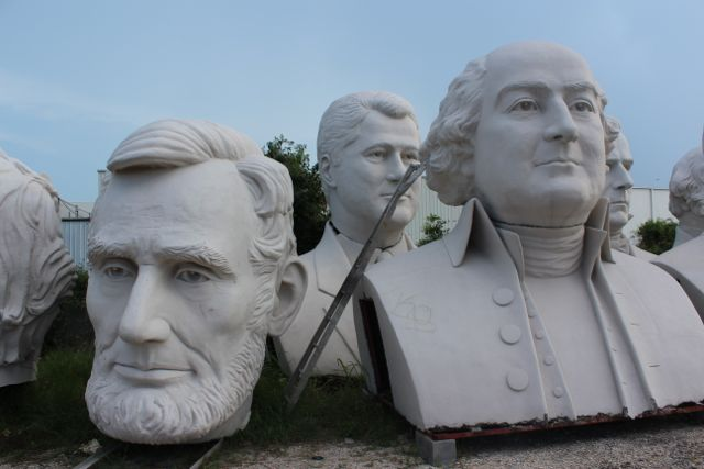 Houston beatles statues president heads things to