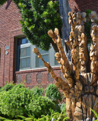 galveston-wood-sculptures-'Where Have All the Flowers Gone' on Church Street