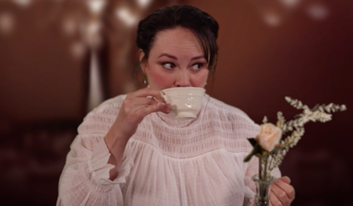 An actress sips on a cup of tea.