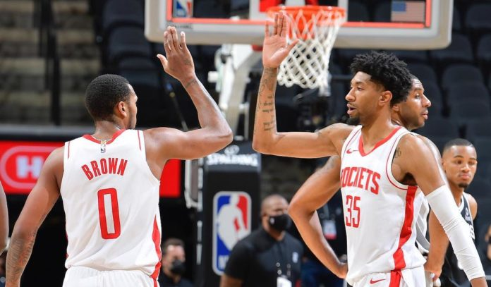 Houston Rockets teammates Sterling Brown and Christian Wood high five