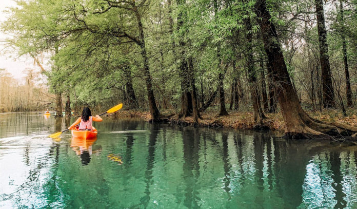 Paddling in a scenic waterway in Village Creek State Park